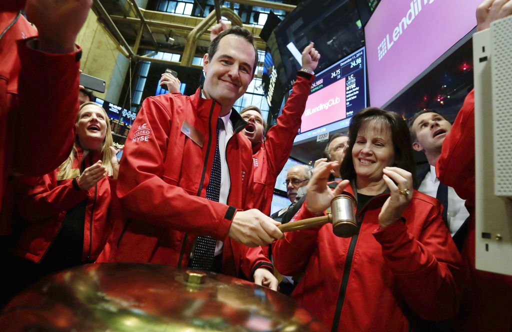 Renaud Laplanche, left, Founder & CEO of Lending Club, hands the gavel to company CFO Carrie Dolan after he rang the ceremonial first trade bell, during his company's IPO, on the floor of the New York Stock Exchange, Thursday, Dec. 11, 2014. (AP Photo/Richard Drew)